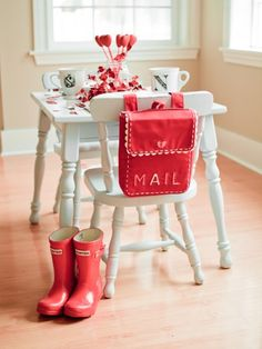 valentine kid table -- H & E have these mailboxes (with their names embroidered on them) and they hang on the back of their Carolina style (PBK) chairs.  They love putting letters (and other assorted treasures) in them all year long!