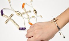 Groupon - $11 for a Jadore Bijoux Cross Gem Pull-String Bracelet ($50 List Price). 18 Styles Available. Free Returns.  in Online Deal. Groupon deal price: $11.0.00