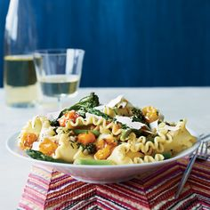 Star chef Mario Batali's outstanding #spring vegetable #pasta boasts juicy roasted tomatoes with asparagus, Broccolini and shavings of ricotta salata cheese.