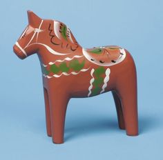 """Carved Wooden Dala Horse (Dalahäst) - Antique Red - Traditional Red. 3"""" Tall. FromNils Olsson Dala Horses  (Dalahäst) - Since 1928 - The Premier Dala Horse Workshop - Swedish National Symbol - The Scandinavian Folk Art. Handcrafted in Nusnäs, Dalarna, Sweden. Visit www.mygrowingtraditions.com for this and other Nils Olsson Dala Horses."""