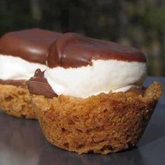 S'more Cups -- homemade graham cracker crust filled with broken chocolate candy bars and large chocolate-dipped marshmallow.