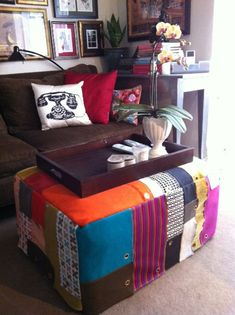 Ottoman covered in (potentially free) fabric samples. She even left the grommets in!