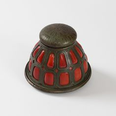 A Tiffany Studios New York patinated bronze and red blown glass Inkwell, c. 1900