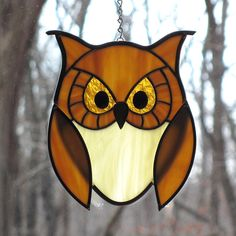 i want this or something like this for my new kitchen window! :) Stained Glass Golden Owl with Golden Eyes Suncatcher. $50.00, via Etsy.
