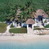 The thatched-roof Beach House sits on a private crescent-shaped beach and offers intimate lodging with one bedroom and an open-air living room and bathroom. See more of the resort at HGTV FrontDoor.com. | HGTV FrontDoor
