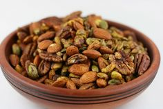 Crock Pot Roasted & Spiced Nuts Recipe _ With: pecans, almonds, pistachios, & pumpkin seeds.