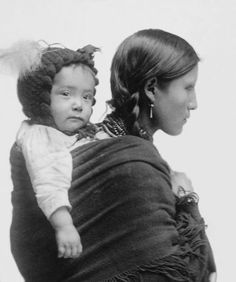 Mother and child - Native American woman from Great Plains region c1901