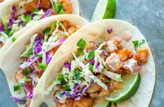 These Spicy Sriracha Shrimp Tacos are fast, flavorful, and topped with a zesty Cilantro Lime Slaw that will rock yours socks! These healthy shrimp tacos are the best! Spicy Shrimp Tacos, Shrimp Taco Recipes, Fish Recipes, Mexican Food Recipes, Dinner Recipes, Slaw Recipes, Dinner Ideas, Shrimp Taco Sauce, Firecracker Shrimp Tacos