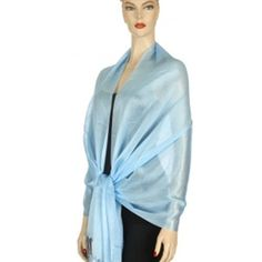 Light Blue Long Simple Wide Georgette Shawl Wrap Luxury Divas. $13.99. Imported. polyester. The scarf wrap is bordered on both ends with silky thread-like fringe.. Makes a great gift.. Classic and simple, and extremely versatile.. Great when worn as a shawl, or even as a head or hip wrap.