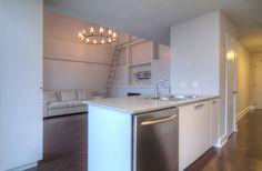 Toronto Lofts, Lofts For Rent, High Windows, Gas Bbq, Living Room Shelves, Lake Shore, Art Deco Buildings, Wall Mounted Tv, Window Wall