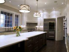 White cabinets, dark island, white quartz countertops