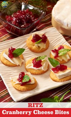 Our Cranberry Cheese Bites taste just like Christmas. Place softened brie cheese on a RITZ cracker and top if off with cranberry sauce and a mint leaf. Deeelicious!