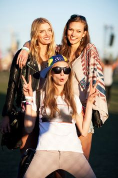 Karlie, Lily, and Cara at Coachella... in a boobs T-shirt! Photographed by Mark Iantosca