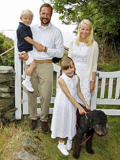 Norwegian Royals Prince Haakon and his wife Mette Marit, their children Ingrid and Sverre Magnus with their dog Milly Kakao