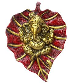 Divinecrafts Metal Wall Hanging of Lord Ganesha on Leaf Showpiece