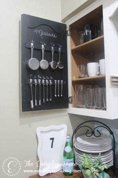 DIY:  Organized  Measuring Cup/Spoon Cabinet - great DIY on how this cabinet was organized & how the utensils were hung. This could be the start of an organized baking cabinet.