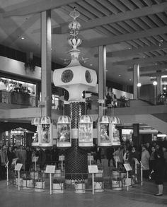 Photograph of a clock at the Midtown Plaza Shopping Center in Rochester, New York.
