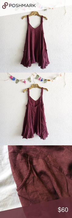 Free People Maroon Swing Dress Beautiful rich, maroon colored dress with a raw finished hem. Has so much flounce and movement! And an added bonus: it has pockets! Size small. In excellent pre-owned condition! Free People Dresses