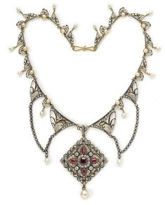 Giuliano necklace set with diamonds, rubies and pearls.  Holy yummy!  Made around 1890 in the Renaissance Revival style.
