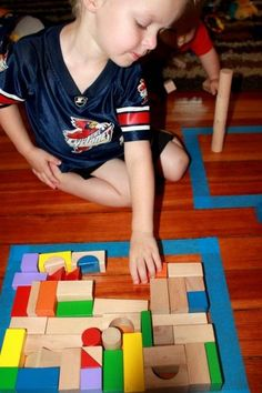 Make your own puzzle with tape on the floor and blocks: The goal is to fill the shape with blocks without leaving any holes. Great problem solving activity! ~ Hands On As We Grow