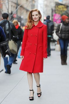Jessica Chastain goes for a walk in a Michael Kors coat paired with Rupert Sanderson sandals.