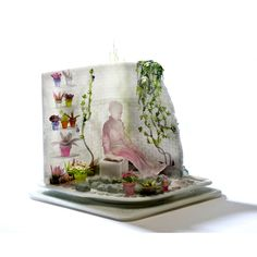 08-06-2016 glass vignette with flowers, woman in pink seated. Emily Brock, glass artist at Wexler Gallery in Philadelphia, PA.