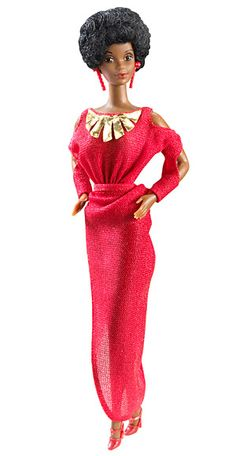 African American Barbie, 1980  Although there were other African American dolls in the Barbie family, like Francie (1967), Julia (1968), and Christie (1968), this 1980 doll was the very first African-American Barbie. She came dressed in a glam red gown with gold trim, and matching dangling earrings