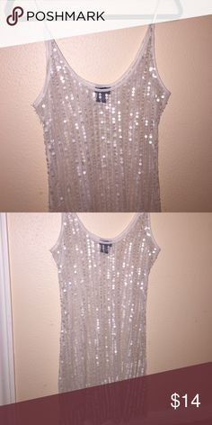 NWOT sequin sheer tank NWOT ivory sheer sequin tank. Front and back are identical covered in sequins. Never been worn. Long shirt. Size XL. Tops Blouses