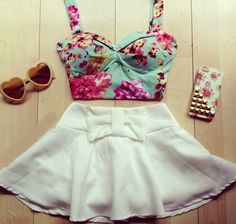 Such a cute outfit floral crop top, bow skirt, heart sunglasses and floral and studded phone case.Reminds me of something Ariana Grande would wear