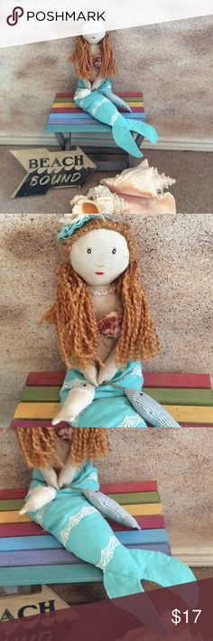 """Nautical Missy the Mermaid New with out tags is sweet and mysterious Missy the mermaid to help brighten up all your nautical needs.  Red braided hair with shell bikini top and aqua tale. Approximately 22"""" in length. Unbranded Other"""