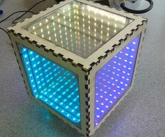 Woodworking Course Infinity Mirrors - The dazzling infinity mirror effect is achieved using two mirrors: a regular mirror with LEDs in front of it, and a second one-way mirror that reflects the LED image.