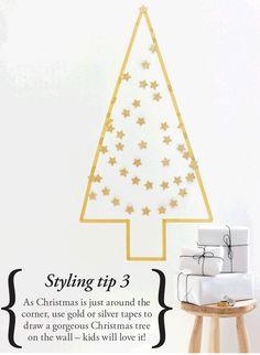 Arbol de navidad hecho con washi tape y guirnalda