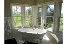 Master Bath...like the tub and the bead board.  Beautiful light...