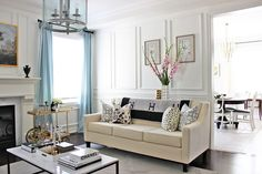 Living room design, Hermes Avalon blanket, Chanel coffee table books, Curated style, Pink Gladiolus, Schumacher Hollyhock pillow, Brunschwig & Fils LES TOUCHES pillow, Vintage brass bar cart, Target Nate Berkus geo vases