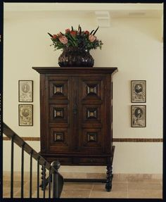 Thomas Callaway - Associates - Interior Designer - Los Angeles - Mediterranean - Moroccan - Gallery - Art - Frames - Display - Wood - Chest - Armoire - Staircase - Tiled Floor - Neutrals - White
