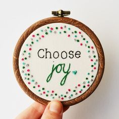 A miniature hoop art featuring the inspirational quote 'Choose joy' stitched by hand. Made by PixieCraft