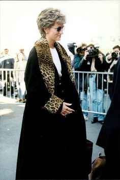 Princess Diana circa 1991. I think Diana also wore this coat Feb 11, 1991 in Devonport to visit departing Sailors on their way to the Gulf War. Wearing a long black coat with leopard print lapels.