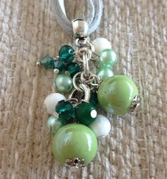 Handmade pendant necklace with ceramic pearls and Green cristal