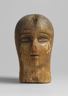 Unusual Early Milliner's Head Form With Stylised Facial Features, Hand Carved Wood with Pin Holes and the Patina of Use, English, Midlands, c.1870