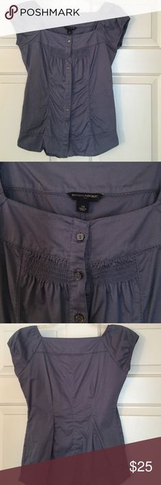 Banana Republic cap sleeved blouse NWOT.  Never worn.  Cute button up blouse.  Color is blue with a hint of grey.  97% cotton 3% elastane. Banana Republic Tops Button Down Shirts
