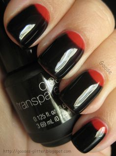 black nails with red half-moons; too cool