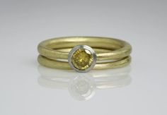 Jean Scott-Moncrieff - 18 carat yellow gold ring with white gold setting and canary yellow natural diamond with matching tapered ring