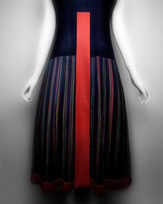 """Paul Poiret (French, 1879–1944). """"Mademoiselle"""" dress, 1923. Black and red wool crepe with polychrome striped wool twill. The Metropolitan Museum of Art, Catharine Breyer Van Bomel Foundation Fund, 2005 (2005.210) 