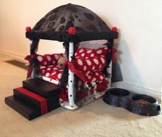 Small doggie canopy bed. Turn an old side table upside down and start playing with paint. Sew or pick up some pillows and tada! Toy dog canopy bed!!