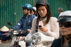 woman talking on her phone while riding a motorbike in Hanoi Vie Motorbikes, Gadgets, Bikini, Hanoi Vietnam, Women, Phone, Life, Bikini Swimsuit, Telephone