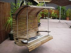 Outdoor swing with acacia timber slat screen