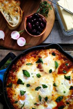 Portuguese Style Baked Eggs {cheesy eggs in spicy red pepper tomato sauce}