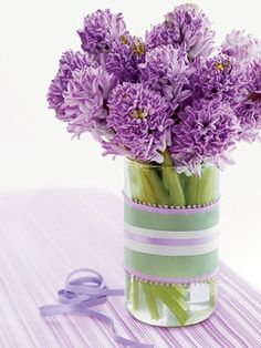 Don't let the adage fool you: April's flowers herald spring just as much as May's post-shower buds. And what smarter way to display a bunch of hyacinths or daffodils than with this easy update of a basic glass vase? To do: Head to a crafts store (or raid your own sewing stash) for a few lengths of ribbon in complementary hues and of varying widths. Layer them, as we did here; use double-sided tape to hold them in place. Trim ribbon ends neatly to finish.