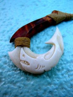 "Hawaiian Mano Makau~ ""Shark Fish Hook"" carving (Composite of * Curly Koa wood and bone)  The deep reverence and connection the Hawaiians had to the"