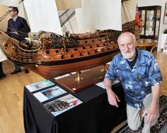 """Victor Jankovic shows off the model ship he spent six years building, in Vancouver on June 11, 2013. The HMS Royal William 1/32 model is a fully """"functioning"""" model that sails in water and appears realistic when filmed and photographed among its surroundings. It will be sold at auction by Maynards on June 19, 2013. Maynards has estimated the model's value at $9,000 to $12,000."""